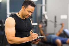Gym trainer clipboard Stock Photography