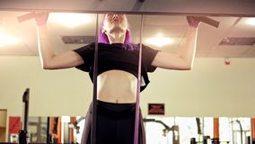 Gym training athletic woman doing pull ups gym stock footage