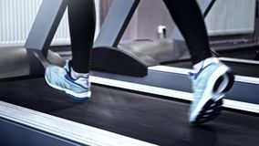Gym training cardio workout legs running treadmill stock footage