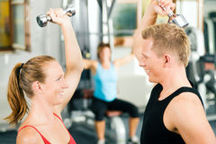 Gym training with dumbbells Stock Photos