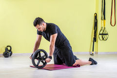 Gym training  with wheel on the floor. Stock Images