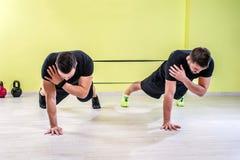 Gym training. Workout fitness exercise Stock Photos