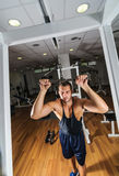 Gym training workout. Young adult man is working out in gym Stock Photography