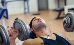 Gym training workout. Young adult man is working out in gym Stock Photo