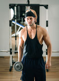 Gym training workout. Young adult man is working out in gym Stock Images
