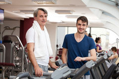 Gym training, young man and his father Royalty Free Stock Images