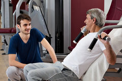 Gym training, young man and his father Royalty Free Stock Photography