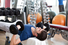 Gym training, young man and his father Royalty Free Stock Photos