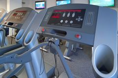 Gym treadmill exercise machines. Perspective corrected Royalty Free Stock Photo
