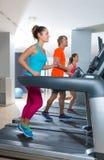 Gym treadmill group running indoor Stock Photo