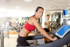 Gym treadmill running young woman interior Stock Images