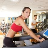 Gym treadmill running young woman interior Stock Photos