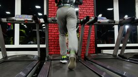In the Gym: Treadmill,. In the Gym: Treadmill. Young man jogging stock video footage
