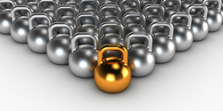 Gym weight kettle bells. Gold gym weight kettle  standing out of the crowd Royalty Free Stock Photos