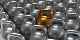 Gym weight kettle bells. Gold gym weight kettle  standing out of the crowd Royalty Free Stock Image