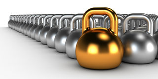 Gym weight kettle bells in a row. Gold gym weight kettle  standing out of the row Stock Photo