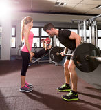 Gym weightlifting couple workout barbell dumbbell Royalty Free Stock Image