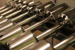 Gym Weights - Selective focus. A rack of weights in a gym stock images