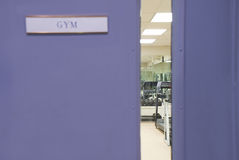 Gym Window. Looking into a gym through a window. Focus inside room Royalty Free Stock Images