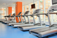 Gym with windows and running machines Royalty Free Stock Image
