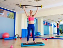 Gym woman barbell exercise workout at gym Royalty Free Stock Image