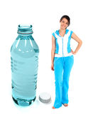 Gym woman with a bottle of water Royalty Free Stock Photo