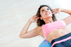 Gym woman doing crunches Royalty Free Stock Photography