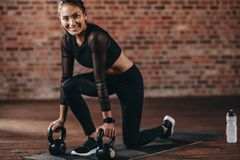 Gym woman doing exercise with kettle bell stock image