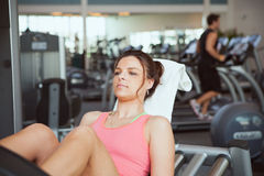 Gym: Woman Doing Leg Press in Gym Royalty Free Stock Photography
