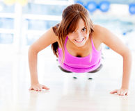 Gym woman doing push ups Stock Photos