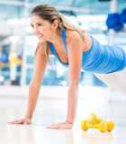 Gym woman doing push ups Stock Photography