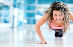 Gym woman doing push ups Royalty Free Stock Images