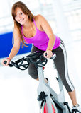 Gym woman doing spinning Royalty Free Stock Image