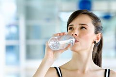 Gym woman drinking water Royalty Free Stock Photo
