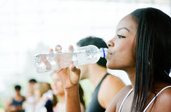 Gym woman drinking water Stock Photography