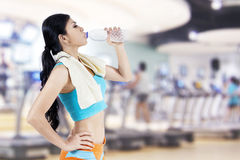Gym woman drinking water Stock Image