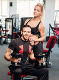 Gym woman exercising with her personal trainer Royalty Free Stock Photo