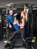Gym woman exercising with her personal trainer Stock Image