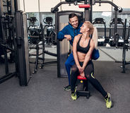 Gym woman exercising with her personal trainer Royalty Free Stock Images
