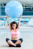 Gym woman with fitness ball Stock Images