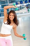 Gym woman with free-weights Royalty Free Stock Photos