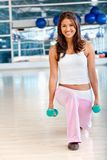 Gym woman with free-weights Royalty Free Stock Photo