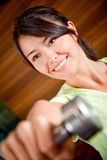 Gym woman with free-weights Stock Photo