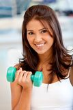 Gym woman with free-weights Stock Images