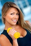 Gym woman with free-weights Stock Photography