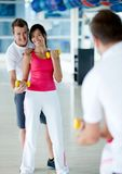 Gym woman with her trainer Royalty Free Stock Images