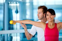 Gym woman with her trainer Stock Images