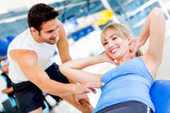 Gym woman with her trainer Stock Photo