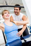 Gym woman with her trainer Royalty Free Stock Image