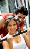 Gym woman and her trainer Royalty Free Stock Photography